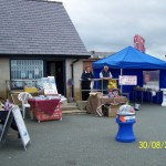 Rhyl Lifeboat Fundraisers alongside boathouse shop