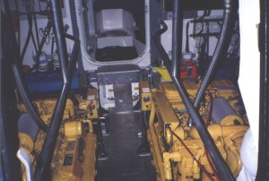 Engine room from wheelhouse.2 x Caterpillar 3208T turbo charged Diesel engines.