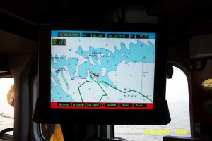 The Global Positioning System plotter screen, showing track of lifeboat over chart of local area.