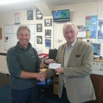 Arthur sails round Wales and presents cheque to the Rhyl RNLI Shannon new lifeboat appeal.