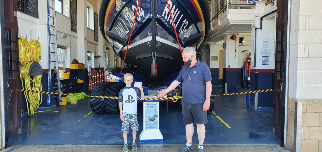 Donation to Rhyl RNLI after rescue