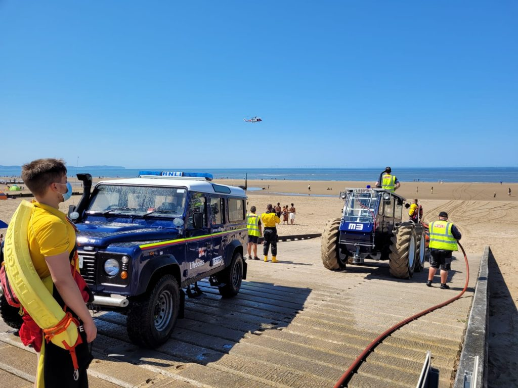 Rhyl lifeboat crew and coastguards assist lifeguards on Saturday 17/7/2021.