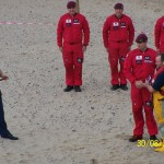 Coxswain Peter Robinson receives his 20-year long service badge from the Red Devils' leader