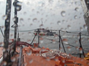 Shows the lifeboat coming alongside the windfarm boat
