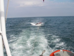 The boat in tow by the lifeboat